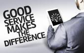 Business man with the text Good Service Makes The Difference in a concept image — Stock Photo