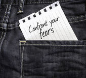 Confront your Fears written on a peace of paper — Stockfoto