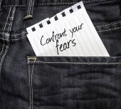 Confront your Fears written on a peace of paper — Stok fotoğraf