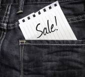 Sale text written on paper — Stock Photo