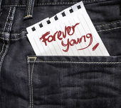 Forever Young written on paper — Stock Photo