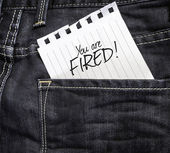 You are Fired written on paper — Stock Photo