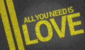 All you Need is Love written on road — Stock Photo