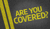 Are you Covered? written on road — Stock Photo