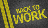 Back To Work written on road — Stock Photo