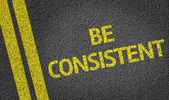 Be Consistent written on road — Stock Photo
