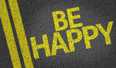 Be Happy  written on road — Stock Photo