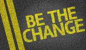 Be The Change written on road — Fotografia Stock