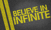 Believe in Infinite written on road — 图库照片