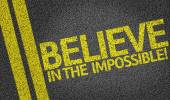 Believe in the Impossible written on road — Stock Photo