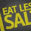Eat Less Salt written on the road — Stock Photo #54642519