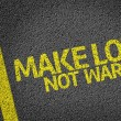 Постер, плакат: Make Love Not War written on the road