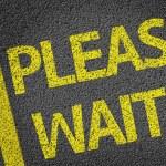 Please Wait written on the road — Stock Photo #54649573