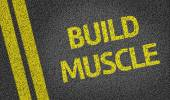 Build Muscle written on road — Stock Photo