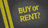 Buy or Rent? written on road — Stock Photo