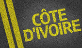 Cote d'Ivoire written on road — Stock Photo