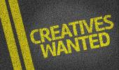 Creatives Wanted written on road — Stock Photo
