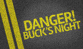 Danger! Buck's Night written on road — Stock Photo