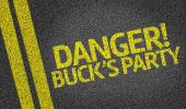 Danger! Buck's Party written on road — Stock Photo
