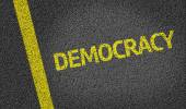 Democracy written on road — Stock Photo