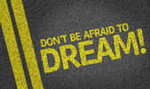 Don't be Afraid to Dream! written on road — Stock Photo