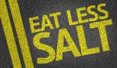 Eat Less Salt written on the road — Stock Photo
