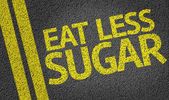 Eat Less Sugar written on the road — Stock Photo