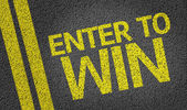 Enter to Win written on the road — Stock Photo