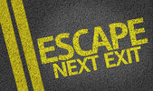 Escape, Next Exit written on the road — Stock Photo