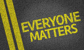 Everyone Matters written on the road — Stock Photo