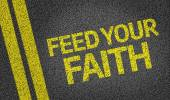 Feed your Faith written on the road — Stock Photo
