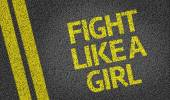 Fight Like a Girl written on the road — Stock Photo