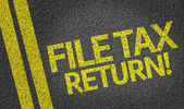 File Tax Return! written on the road — Stock Photo