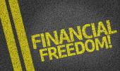 Financial Freedom written on the road — Stock Photo