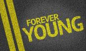 Forever Young written on the road — Stock Photo