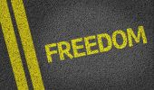 Freedom written on the road — Stock Photo