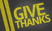 Give Thanks written on the road — Stock Photo