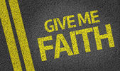 Give me Faith written on the road — Stock Photo