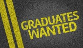 Graduates Wanted written on the road — Stock Photo