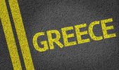 Greece written on the road — Stock Photo