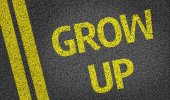 Grow Up written on the road — Stock Photo