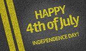 Happy 4th of July written on the road — Stock Photo