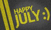 Happy July written on the road — Stock Photo