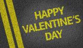 Happy Valentine's Day written on the road — Stock Photo