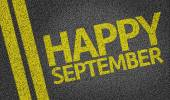 Happy September written on the road — Stock Photo