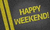 Happy Weekend written on the road — Stock Photo