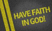 Have Faith in God written on the road — Stock Photo