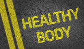 Healthy Body written on the road — Stock Photo