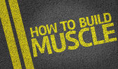 How to Build Muscle written on the road — Stock Photo