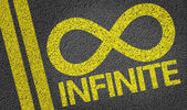 Infinite written on the road — Stock Photo